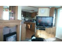 BARGAIN BREAKS ... SANDYLANDS ... 3 BEDROOM FAMILY CARAVAN ...£75. SECURITY..