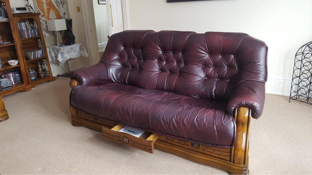 2 Leather Sofas With Carved Wooden Frames And Drawers