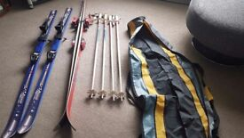 Two pairs of skis and poles plus bag