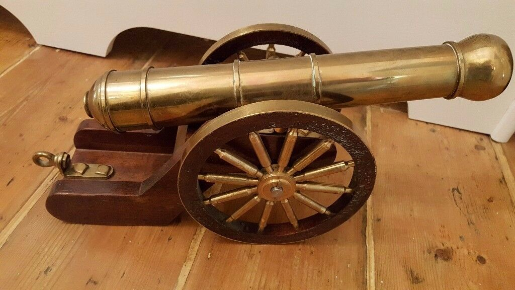 large ornamental cannon, brass and oak