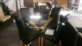 A nrand new excellent quality round glass dining table with 4 chairs.