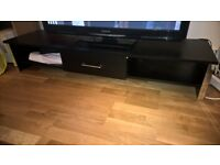 Low black TV stand with drawer