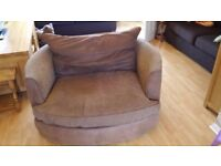 Brown cuddle chair sofa in good condition