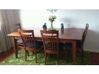 Solid wood dining table with matching console table and 5 chairs.