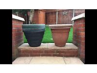 6 green & 2 terracotta large plastic flower tubs