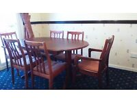 Mahogany effect extending pedestal dining table and 6 chairs ( 2 carvers )