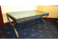 Stylish glass and metal coffee table