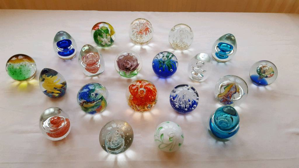 Decorative glass paperweights.