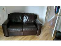 2 seater brown leather settee in really good condition.