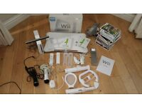MASSIVE WII BUNDLE INC WII FIT CONTROLLERS AND GAMES