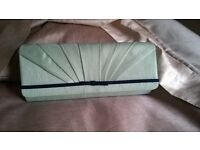 Clutch bag with shoulder strap by Jacques Vert in mint greeen with navy trim