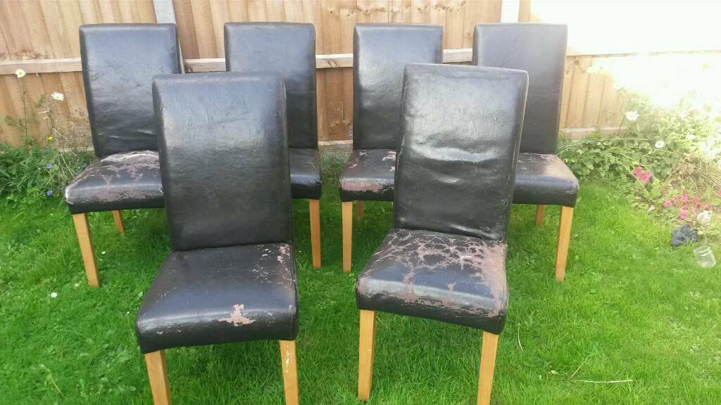 6 faux leather dining chairs in need of recovering