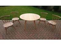 4 x Ercol candlestick chairs and an Ercol drop leaf dining table