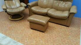 Ekornes leather 2 seater recliner and foot stool