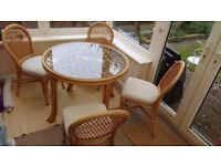 Beautiful cane / wicker dining table and 4 matching chairs 120 ono