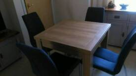 Next table and four chairs