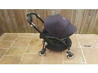 Bugaboo Bee Plus with black chassis and unused rain cover. Great little buggy