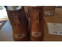 Brand new ugg size 8 chestnut boots. Proof of purchase provided