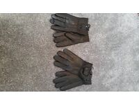 Leather gloves 2 pairs of gloves in black will fit size medium to large. For both £15 or £9 each