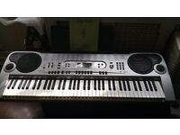 Casio electric keyboard excellent fully working any trial welcomed keys light up to aid tuition