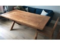 Solid oak dining table with 6 matching chairs