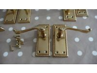 EIGHT SETS OF BRASS DOOR HANDLES