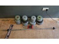 Dumbells weights and approx 49kg plus long bar