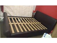 Kingsize faux leather bed in excellent condition