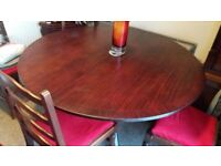 Round teak table .has a built in extension to give you 66 inches wide if required