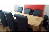 Solid oak dining table with 6 leather chairs