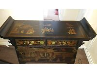 Beautiful Chinese black lacquer village life altar cabinet.