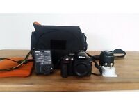 New Nikon D5300 camera w/ 18-55VR lens, carry bag, charger & official Nikon strap