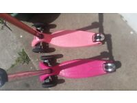 2 pink maxi micro scooter £60each