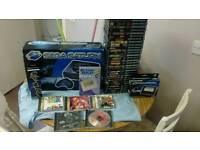 Boxed sega Saturn console and 30 games and more!
