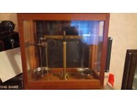 Brass weighing scales in glass case by Griffin & Tatlock with weights