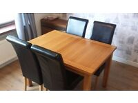 Extending Dining Table & 4 Black Chairs