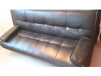 Sofa bed. Black faux leather.