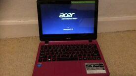 Pink Acer touchscreen laptop