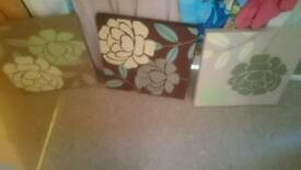 Three floral canvas pictures