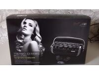 Heated hair rollers. Thermo ceramic fast high heat for lasting results. As new still boxed