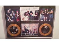 AC/DC framed autographs and Gold disks