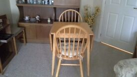 Drop leaf pine table c/w 2 matching chairs & cushions