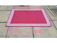 2 pinky red rugs with gingham edging