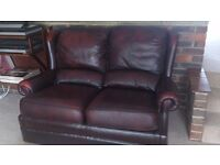 Dark leather 2 seater sofa