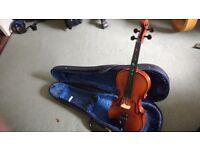 Quarter size violin with hard case