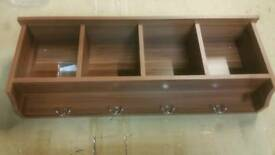 A brand new brown wall mounted hall storage unit with coat hooks.