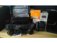 Dslr bundle (Canon 1300D + grip, 50mm lens + hood, tripod, bag and more)