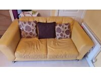 DFS double sofa with a chair and a foot stool