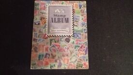STAMP ALBUM.....FULLY ILLUSTRATED PLUS AN EXTRA FOLDER OF LOOSE STAMPS