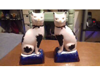 A Paif of 19th C Staffordshire Cushioned Cats